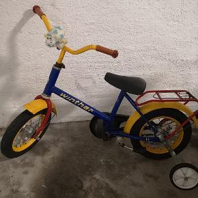 12' winther cykel med støtte hjul, sælges da den er for lille, stadig med en masse kilometer i sig 😊