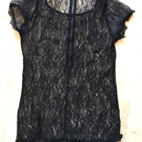 Blonde t-shirt fra By Malene Birger. Jeg har klippet mærket med størrelse af, men mener, at der en str. 40.