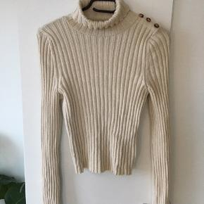 Ribbed turtle neck with button detailing on left shoulder (also extra long sleeves) :)