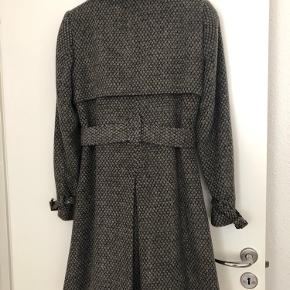 Soft feel trench coat. Used just a few times. Like new.