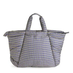 With an all-over houndstooth print, this standout tote features an oversized padded silhouette. Its zip closure opens to a large interior with a zipped pocket. Double top handles and a matching puller finish the look. The lining and padding are made from recycled polyester.  Measurements 650 mm x 480 mm x 210 mm Made from used plastic bottles, recycled-polyester yarn helps reduce waste products and lessens the use of oil-based raw materials  Padding: Polyester 100% Shell: Polyamide 100% Lining: Polyester 100%