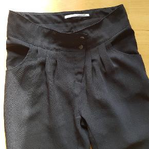 Flotte sorte bukser. Brugt få gange.