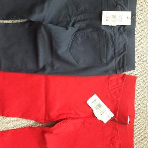 Bukser str 146 Helt nye  Mørkeblå og røde  Fra røgfrit og dyrefrit hjem  30 kr pr par  50 kr for begge par