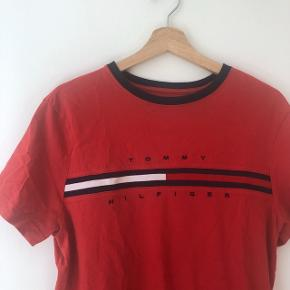 Tommy Hilfiger shirt can be worn by both men and women. Size S for men and around M/L for women. In excellent condition. Check out my other listings and and buy more than one item for a bundle discount!
