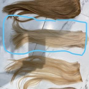 Extensions købt hos DJARLING med fine håndsyet trenser. Brugt en gang i ca 3 mdr. sælges da det er for kort til mit eget hår.  Farve 613 - 6 vævninger svarende til to flettekanter.