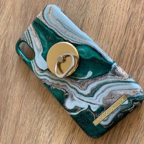 Nærmest nyt cover til iphone xr, incl magnetisk ring. Begge dele fra ideal of sweden. Begge dele brugt een måned, så fremstår nærmest som nyt. Cover koster fra nyt 249 kr. Magnetisk ring koster fra ny 169. Sælges samlet for 350 pp.