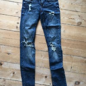 Jeans med huller fra H&M  I behageligt cowboystof