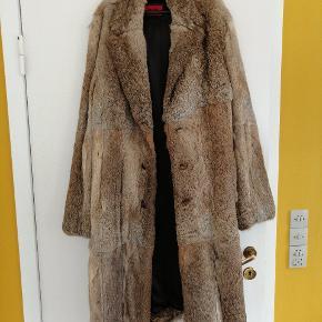 Hugo Boss long length rabbit fur coat. Beautiful coat but l just don't wear it. Size L.