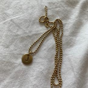 Lovetag fra Jane Kønig. Sælges da jeg ikke får brugt halskæden nok! Fejler ikke noget. Kæden kan købes med hvis det ønskes!