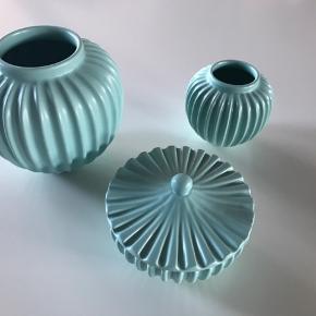 Der er et lille hak i den mindste vase. Designer: Lucie Kaas.