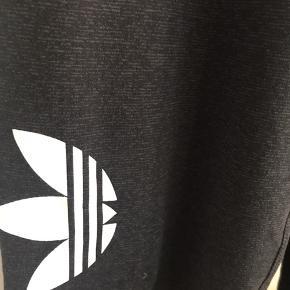 Sort meleret tights fra Adidas str XL. Bløde med behageligt bredt stykke i taljen