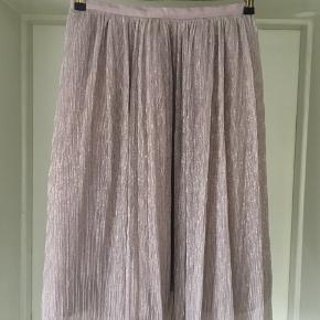 Shiny skirt from Zara.