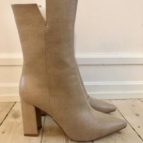 Elegant ankle boots. New but no tags. Never worn. Beige. Croc effect faux leather.