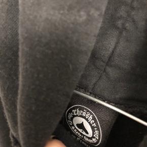 Thrasher hoodie i str m. Brugt, men det er ikke rigtig til at se udover i bindebåndene