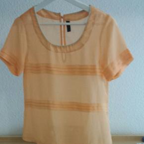 Blouse couleur abricot transparente