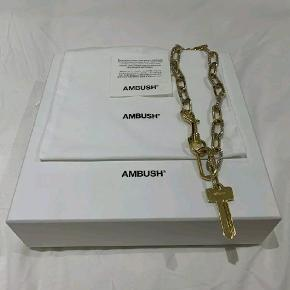 New price: $5528 AmbushxSwarovski gold key necklace Rare! Unisex you can find this necklace modelled on boys and girls if you want to see more photos. Very good condition, no swarovski chrystals missing! Additional photo show proof of the original price they asked for this in different high end webstores. It's obviously dead stock now. For more purchase history google ambush x swarovski key necklace and you can find more history of og price from farfetch etc Copenhagen meet up