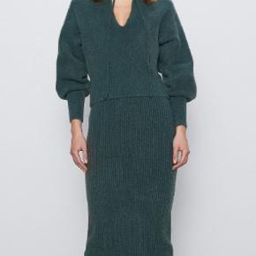 Varm og smuk strik nederdel med 6% uld.