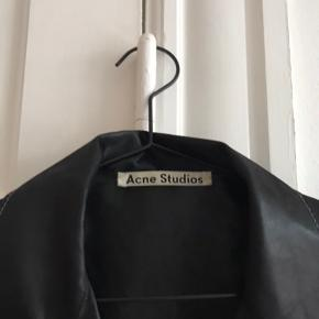 The Acne Studios shirt is in very good condition.