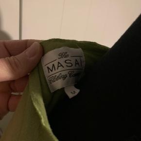 Grøn bluse fra Masai str m. Brugt 1 gang.  Køber betaler Porto.