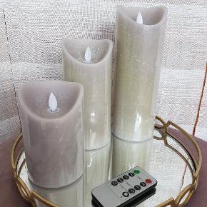 *Prisen er 45 kroner afhentet.  1 sæt bloklys a 3 stk i tre forskellige størrelser, hhv. ca. 12,5cm - 17,5cm - 22,5cm. De er batteri drevne, men er beklædt med ægte stearin og de bruger 2×AA i hver. Farven er en blanding af grå og rosa.  De har flere funktioner, fx. timer. Der medfølger fjernbetjening. Batterier medfølger ikke.  Har dem i 3 forskellige farver.  🌸 SÅDAN HANDLER JEG 🌸  💙 BETALING VIA MOBILE PAY 💙 💚 Varen går til først betalende. 💛 Bytter/refunderer ikke/tager ikke varer retur. 🏠Hentes på Amager, tæt på Bella Center. 📮eller sendes på købers regning med Dao/Gls med mindre andet er aftalt. 📸 jeg sender altid billede af pakken samt forsendelses oplysninger.  VED AFHENTNING: Udlevering af vejnavn når du er på vej. Resten af adr. får du, når du er her. Bliver tit brændt af - på forhånd tak for forståelsen!🏡  Slået op flere steder.   * Ønskes man en TS handel, kommer der TS gebyr oveni prisen.