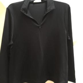 Varetype: Bluse Farve: Sort  stadig med tags
