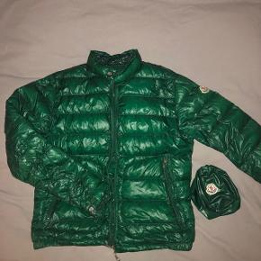 "Green Moncler down jacket, barely used. Size ""2"" in Moncler size, which equals to ""small""."