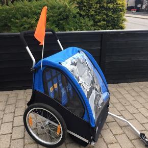 Cykelvogn, kun brugt 3 gange (min datter kan ikke lide at være i den!...), perfekt stand, ren, ingen rust, virkelig flot. Passer til to børn. Hentes i sædding