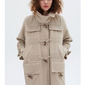 Sælger denne smukke frakke i uld mix med mohair, perfekt til vinteren.