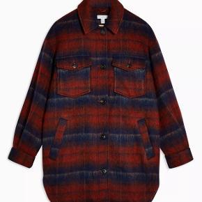 Virkelig flot skjortejakke fra Topshop i uldblanding - superfed til efteråret, men bare ikke min stil. Byd gerne!