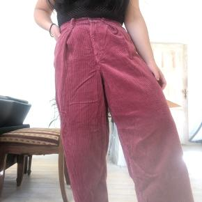 Vintage 70s corduroy high waisted wide leg pants in excellent almost brand new condition. Super stylish and comfortable. Sizing is a little strange, probably fits waist 29/30 very well. Super high waisted. Check out my other listings for a bundle discount!