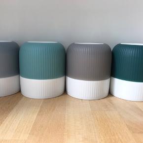 Fire krus i fine farver fra Royal Copenhagen serien  'Contrast'.