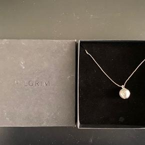 Brand new Pilgrim globe pendant with engraved continents. Comes with a 70 cm long necklace and original box.