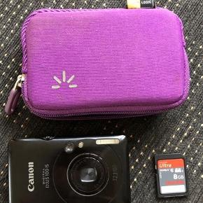 Canon digital kamera incl taske og kort med 32 GB (og ikke 8 som det ses på billedet)  Kameraet har en enkelt skramme, men er ellers fint og fungerer perfekt. Opladere følger selvfølgelig også med :)