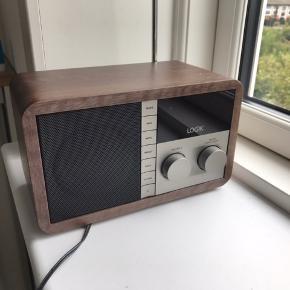 Logik DAB-radio. Fejler intet, sælges da vi ikke får den brugt. For specifikationer se her: https://www.elgiganten.dk/product/tv-radio/radio-og-clockradio/L5DAB13E/logik-radio-dab-internet-l5dab13e#   Sender ikke. afhentes 6700