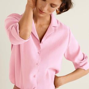 Fin pastellyserød skjorte fra Mango. Størrelse large men passer fint small-medium.