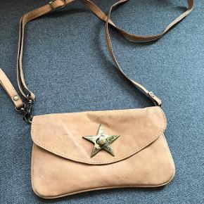 Fin lille Octopus taske, ikke brugt så meget. Men der er lidt slidtage, byd!:)