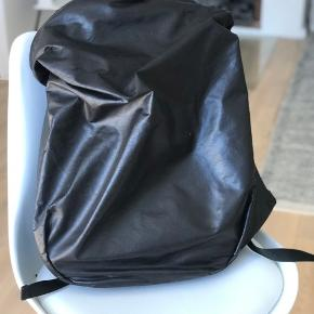 Côte et Ciel rucksack. A few marks on front.  Very good condition. I don't use it anymore.