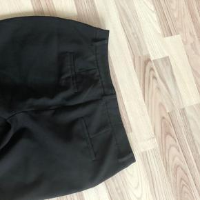 Pæne sorte bukser  nedsat