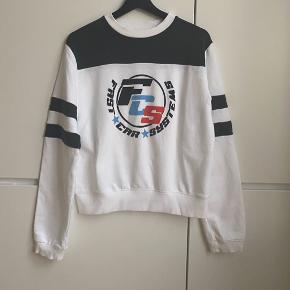 Urban Outfitters cotton white& navy sweatshirt. Colored logo on the front. Size S. Perfect condition, never worn.