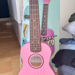 Sælger denne helt nye ukulele