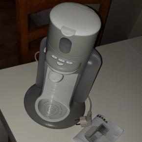 Modermælkserstatning maskineLaver hurtigt den bedste og rette temperatur til din modermælkserstatning. Flasker kan også neutralisere i maskine.