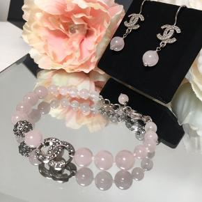 ⭐️🌸CHANEL JEWELLERY SET🌸⭐️  Original, Beautiful Chanel rose pearls set , earrings and bracelet.  Earrings has hook , and cc logo in dark silver, and a rose hanging pearl.  Bracelet made of same pearls, with a dark silver cc logo in crystals, a crystal pearl and lobster clasp lock.  Both items like brand new, never used.  Comes in each original Chanel box.  I  am offering the items together at a favourable price as a set.  Save 531 kr  They can also be bought separately, check previous post.  Shipping 37 kr. DAO  More pictures available 💫