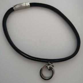 Black leather chocker, can also be used as a bracelet. Really pretty but too small for me. (received as a gift from Baltic countries)