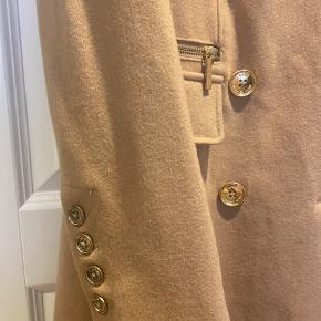 Michael kors uld frakke som ny Med fine detaljer guldknapper  Kun prøvet på
