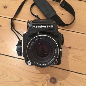 Selling my Mamiya 645 1000S Medium Format camera. The camera comes incl. the lightmeter prismn finder, a Sekor-C 80mm f2.8 lens, and a strap. It's an old camera so condition is obviously not prestine but still good and working. Shot the last roll this summer.