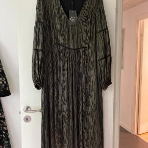 Qué kjole