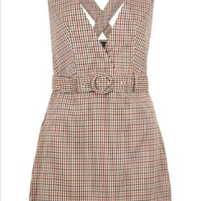Rigtig fin kjole med retro look. Aldrig brugt, da den ikke var noget for mig alligevel.