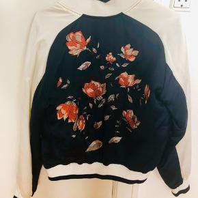 Polyester jacket, size M bit actually Running small so fit S.  Note : there is a white paint mark on the left shoulder as shown on pic 3   #30dayssellout