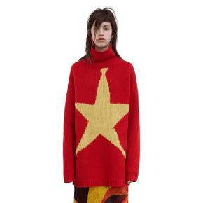 Super flot sweater med gul stjerne