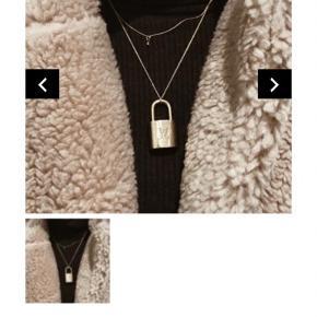 Louis Vuitton Lock købt fra The Vintage Bar. Super flot, slet ikke brugt